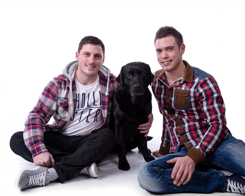 Couples portrait of two young men along with their dog taken at our Aylesbury studio