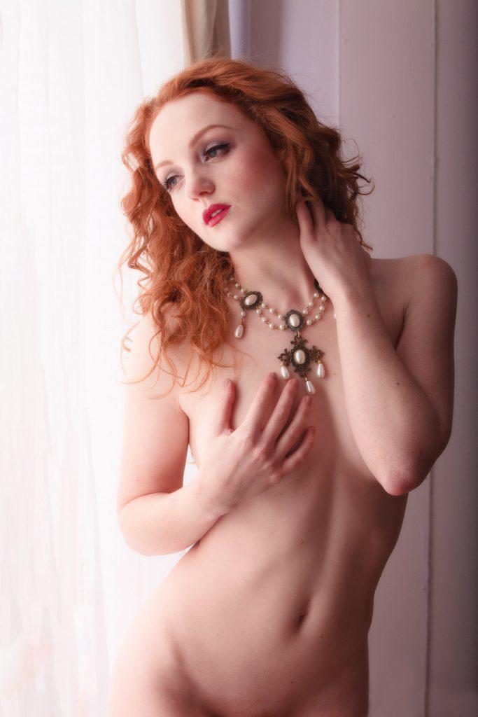 Aylesbury Boudoir photography. Model nude next to window