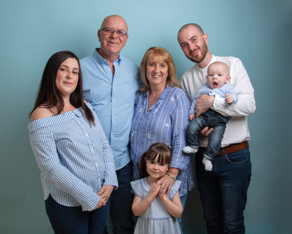 Photo of family of six portrait blue themed taken at our Aylebury studio