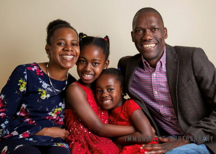 FAmily Portrait of parents with lovely little girls